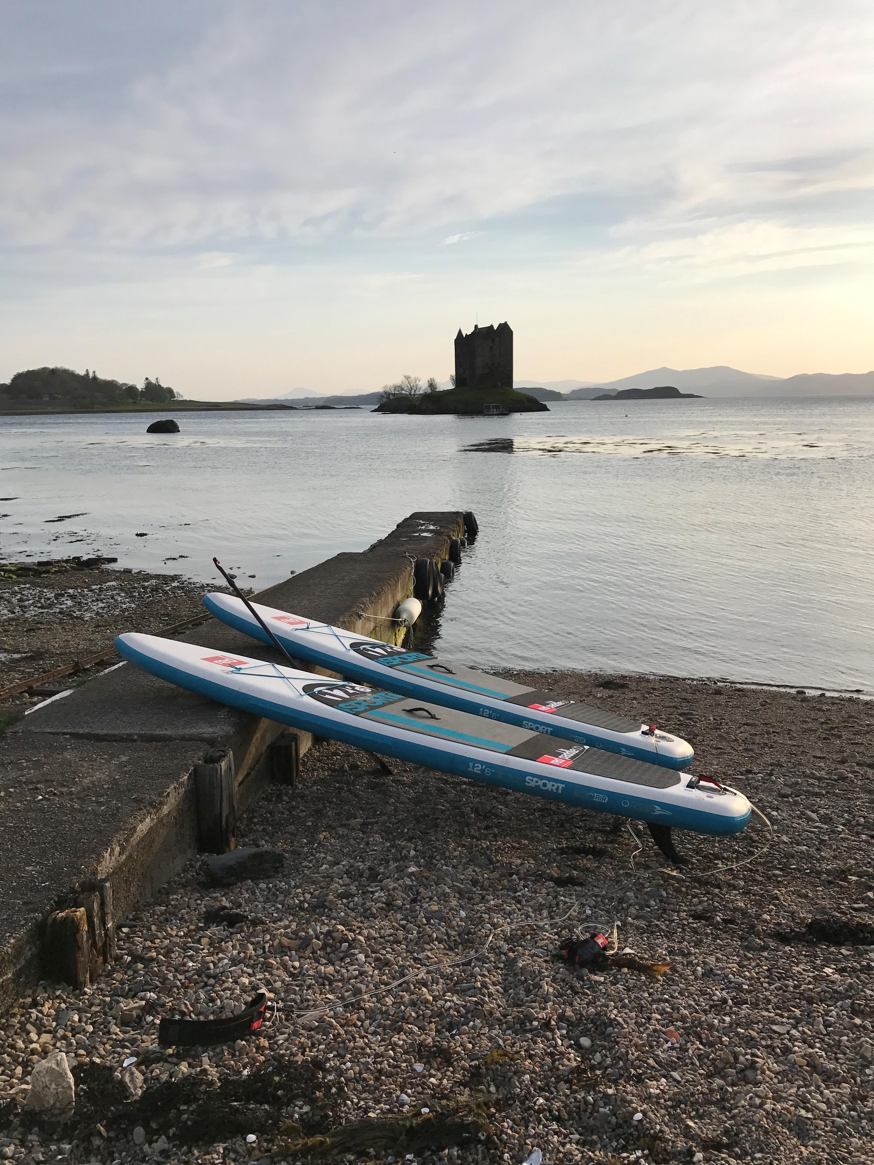Paddle boards in Castle Stalker in Appin
