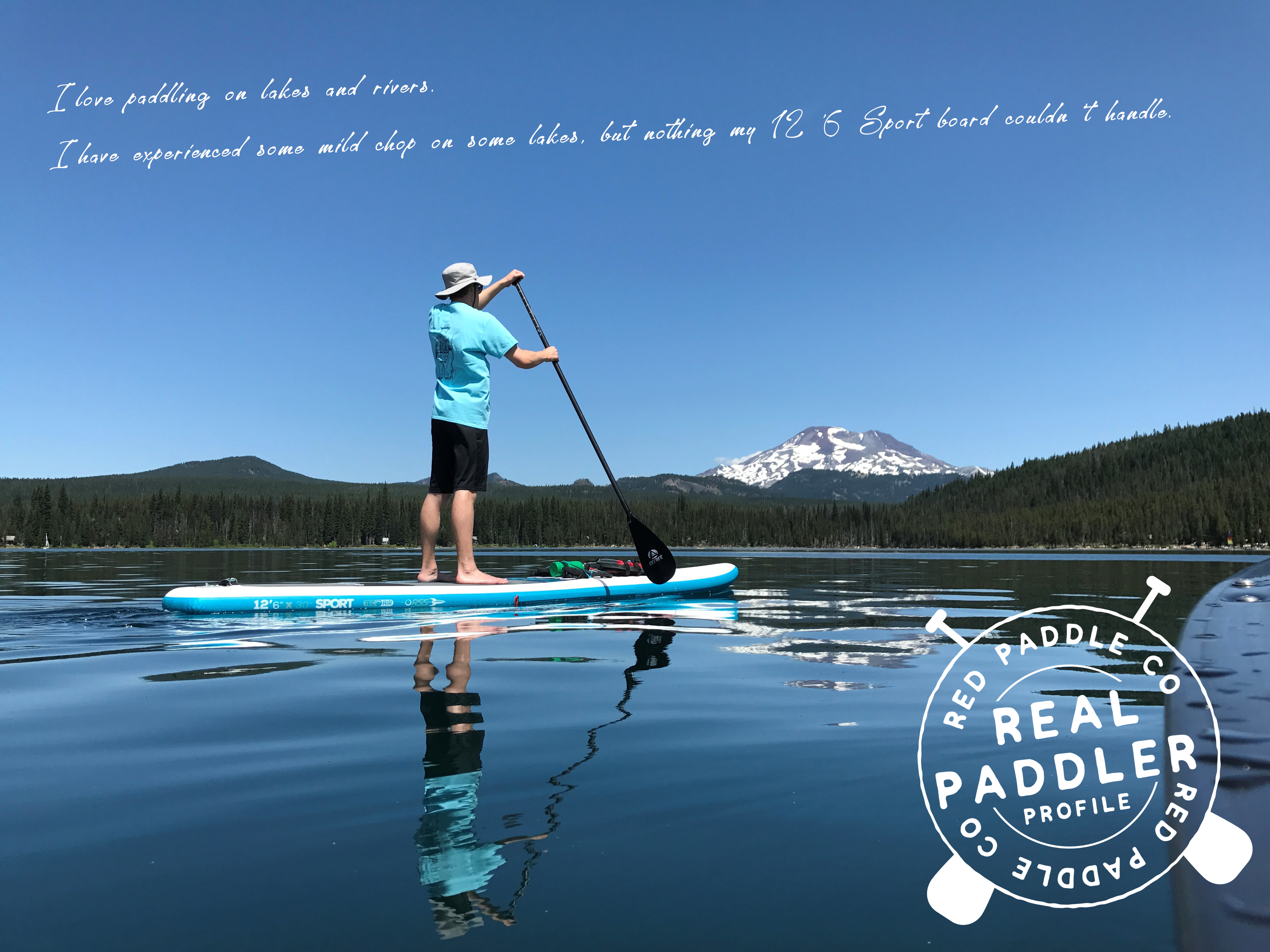 Paddle boarder and mountian lake