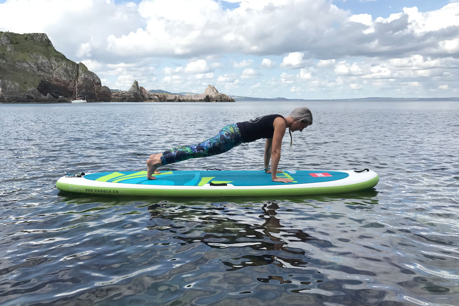 Plank on an inflatable paddle board