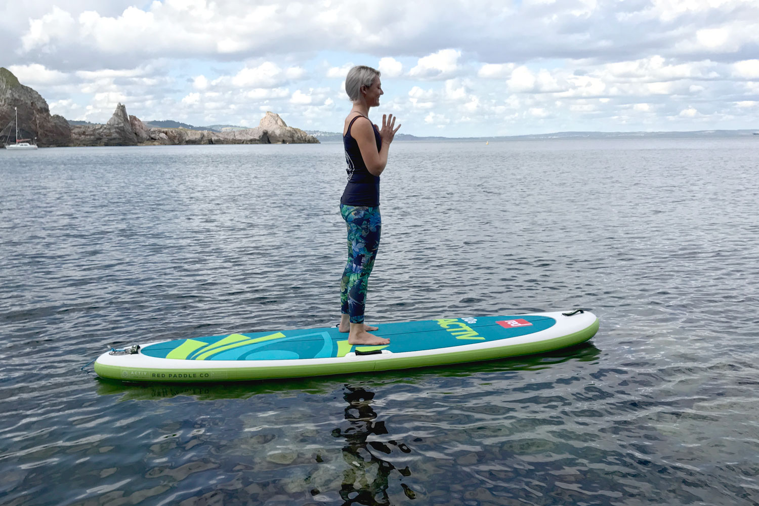 Standing yoga on paddle board