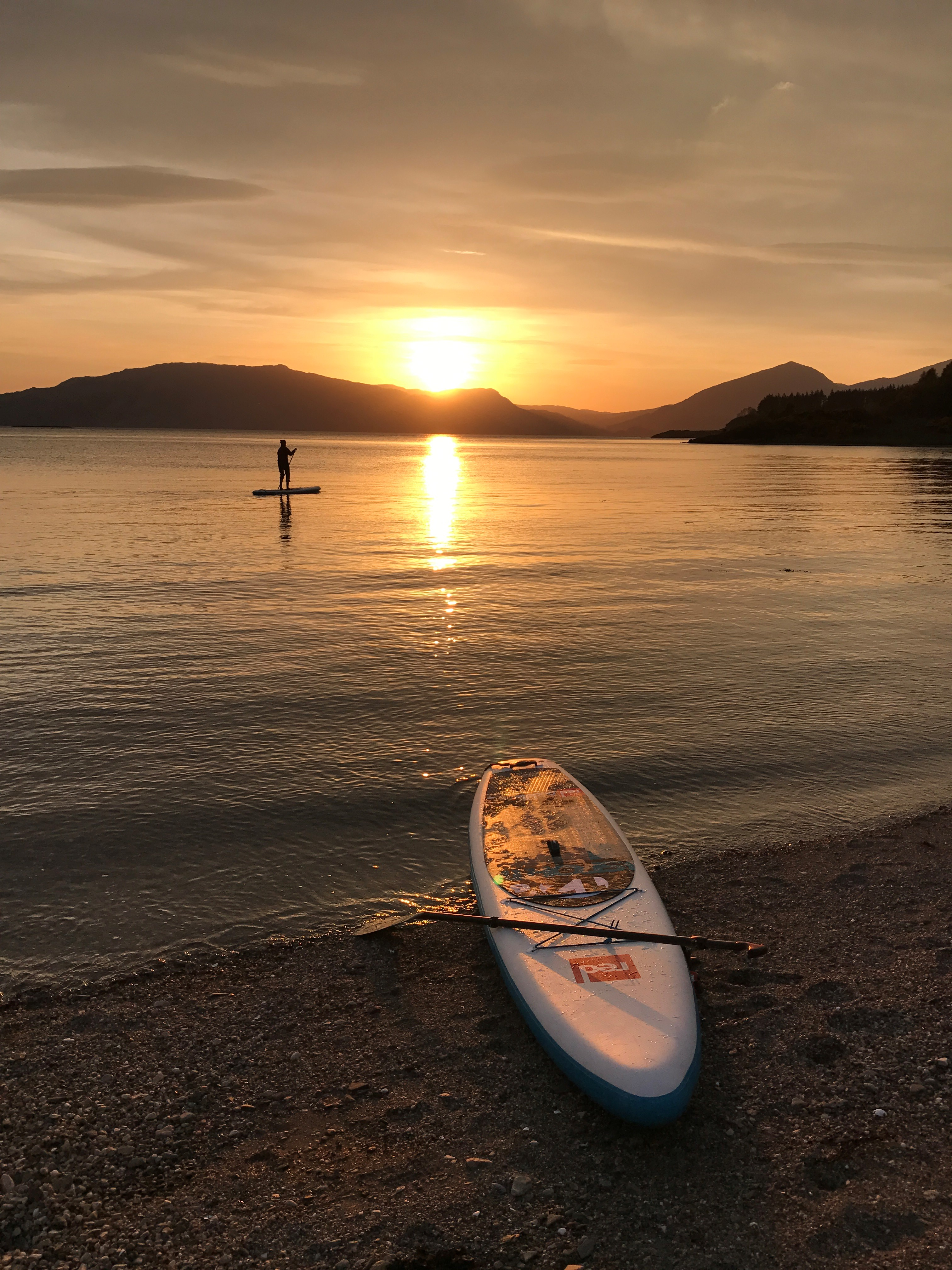 Sundown at Castle Stalker paddle boarding