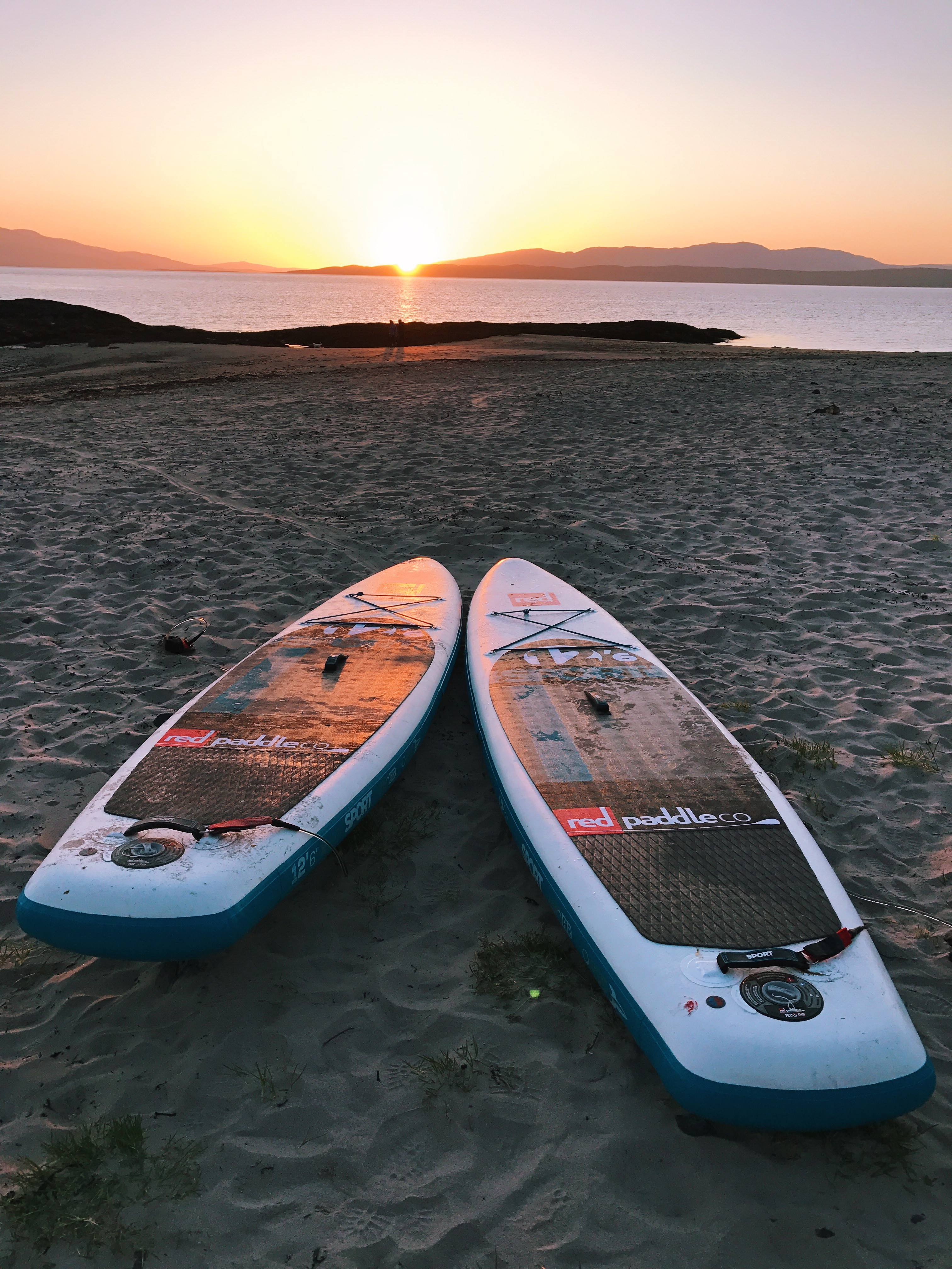 Red Paddle boards at sunset