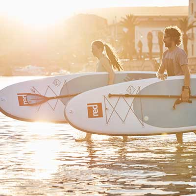 Image of Red Paddle Co Ride boards at sunset