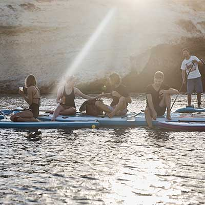 Image of people on a range of Red Paddle Co boards