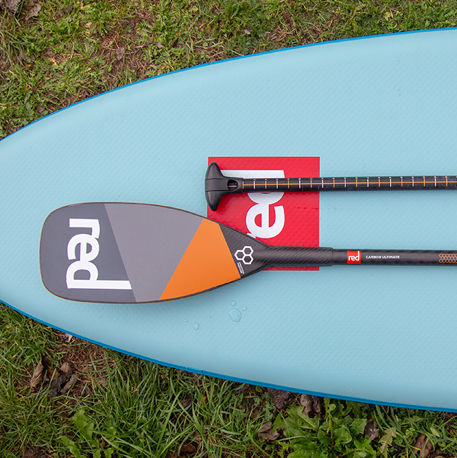 ultimate paddle laid out on Red paddle board