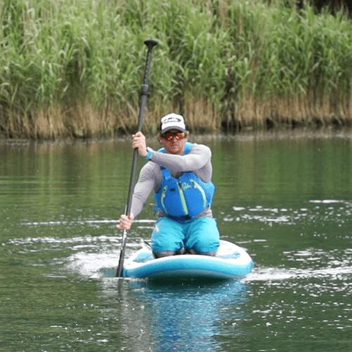 Man paddling on his knees