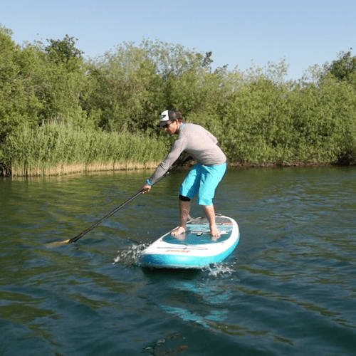 man showing reverse paddle boarding for turning