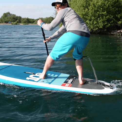man showing turning technique on paddle board