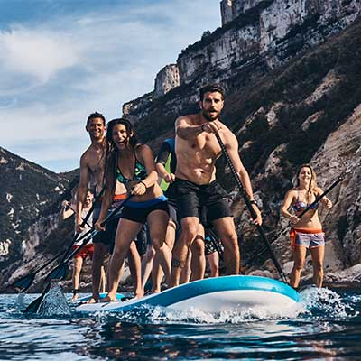 Image of people paddling XL Red Paddle Co board
