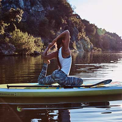 Image of woman doing yoga on SUP board