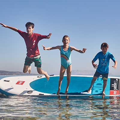 Image of children jumping off inflatable SUP board