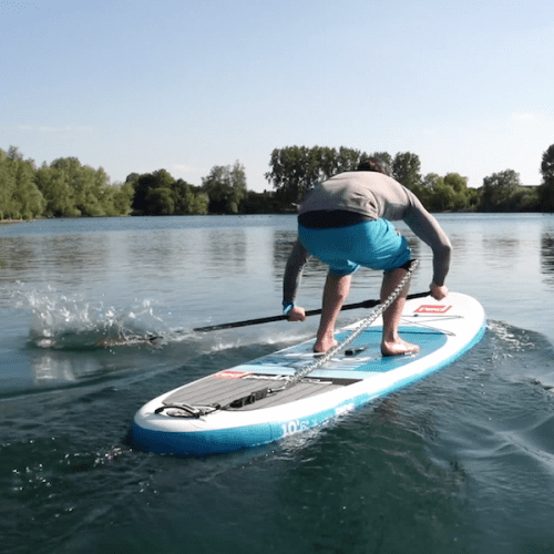 man showing paddle slaps for paddle boarding