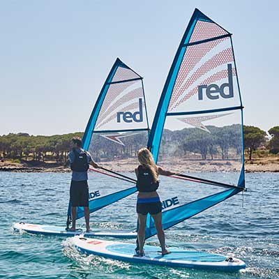 Image of man tacking on SUP windsurf board