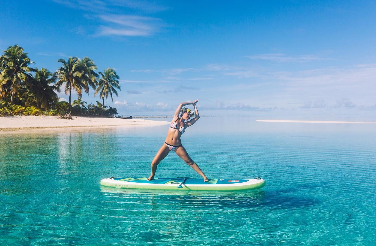 Charlotte Piho shows off her SUP Yoga skills whilst on holiday in the Cook Islands
