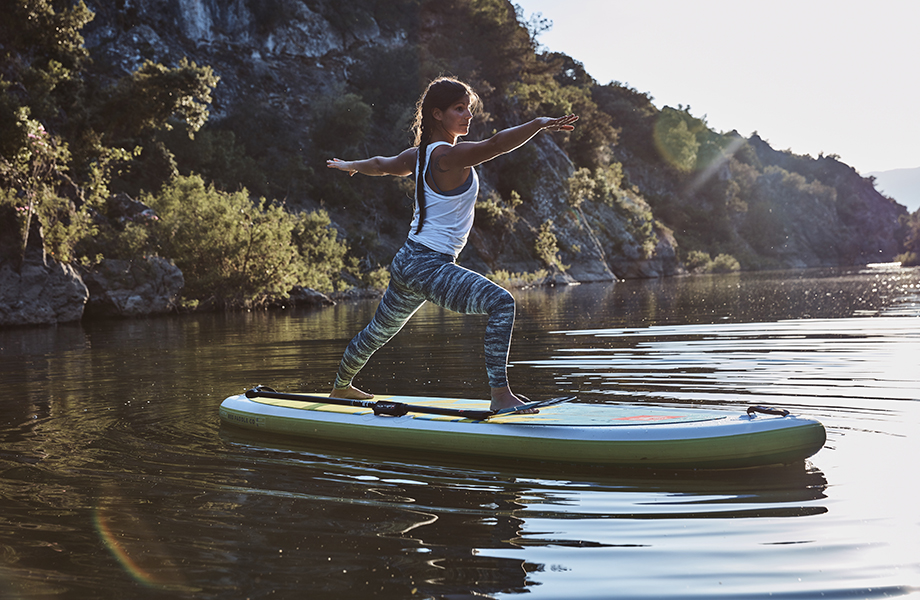 Girl performs sup yoga pose in SUP leggings