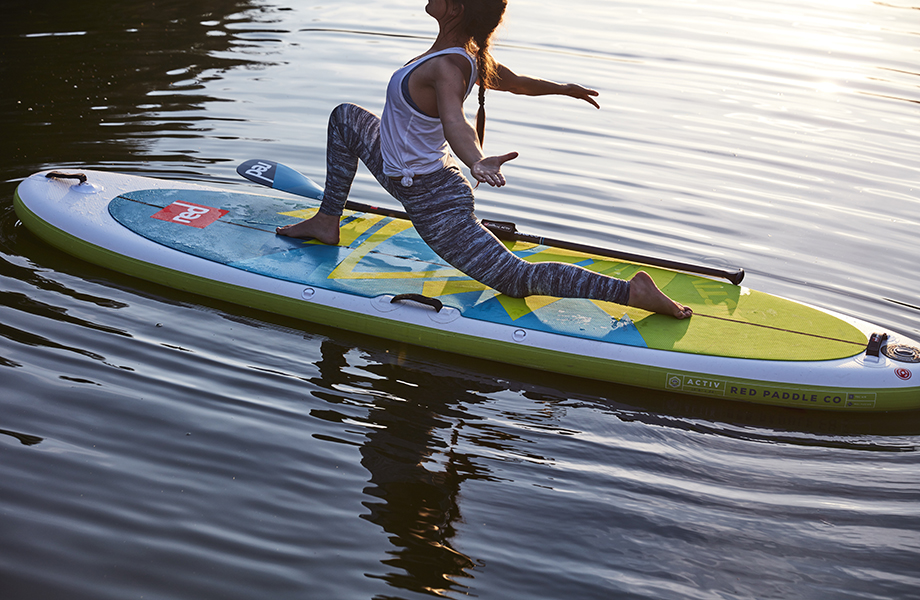 Girl stretches out on her paddle board
