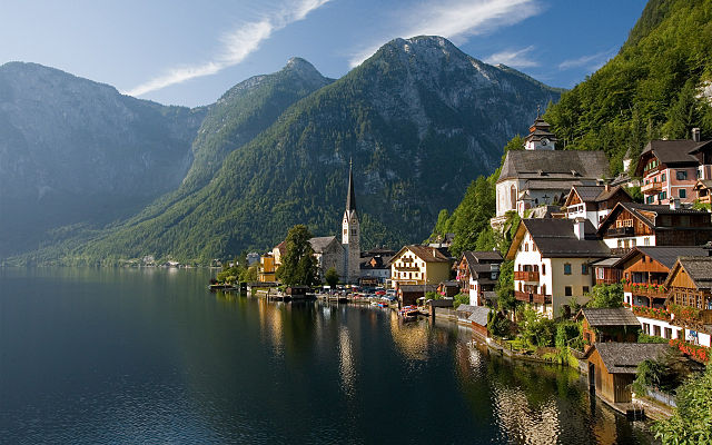 Paddle boarding on the lake as HALLSTATT, AUSTRIA
