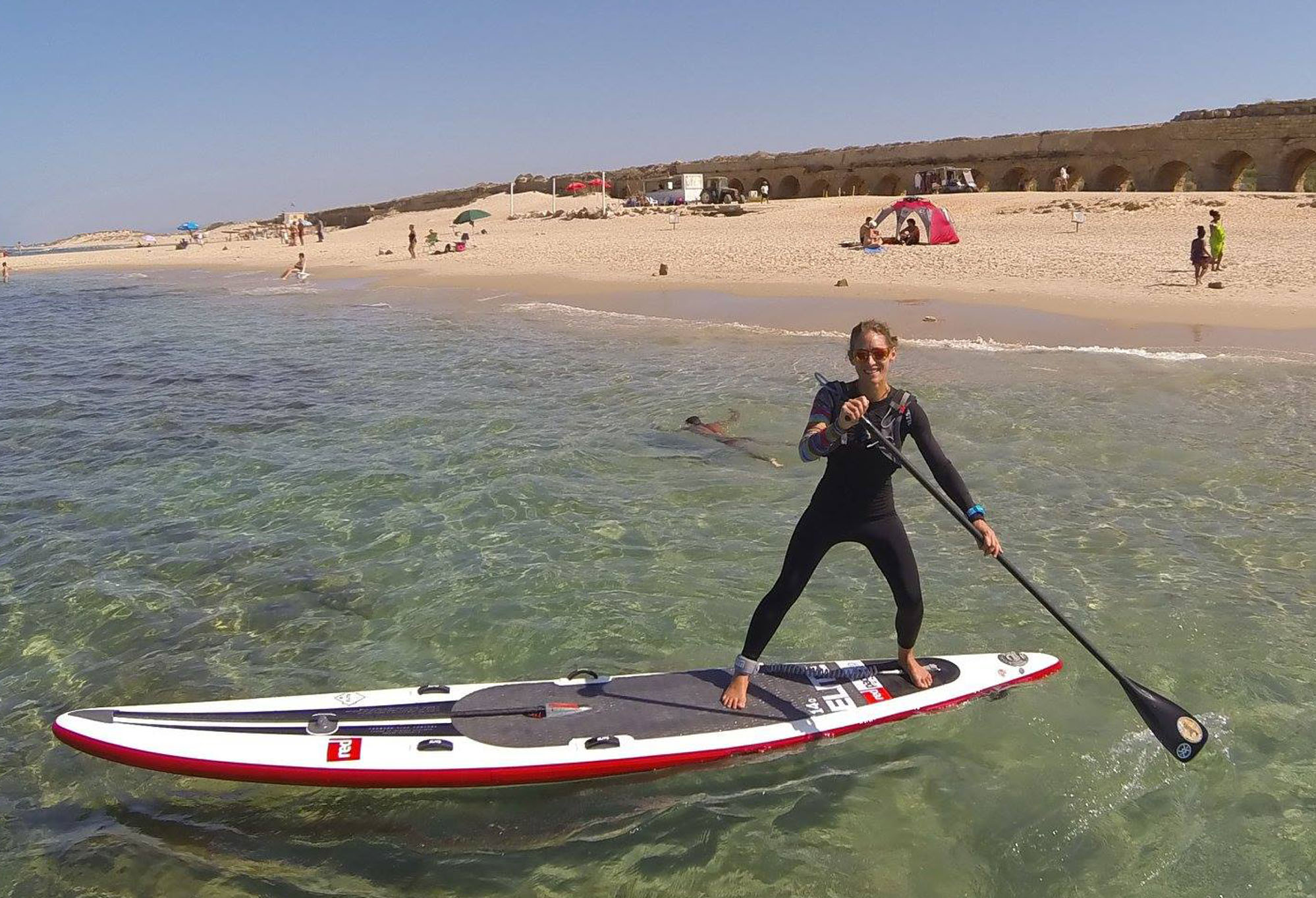 Paddle boarder on beach