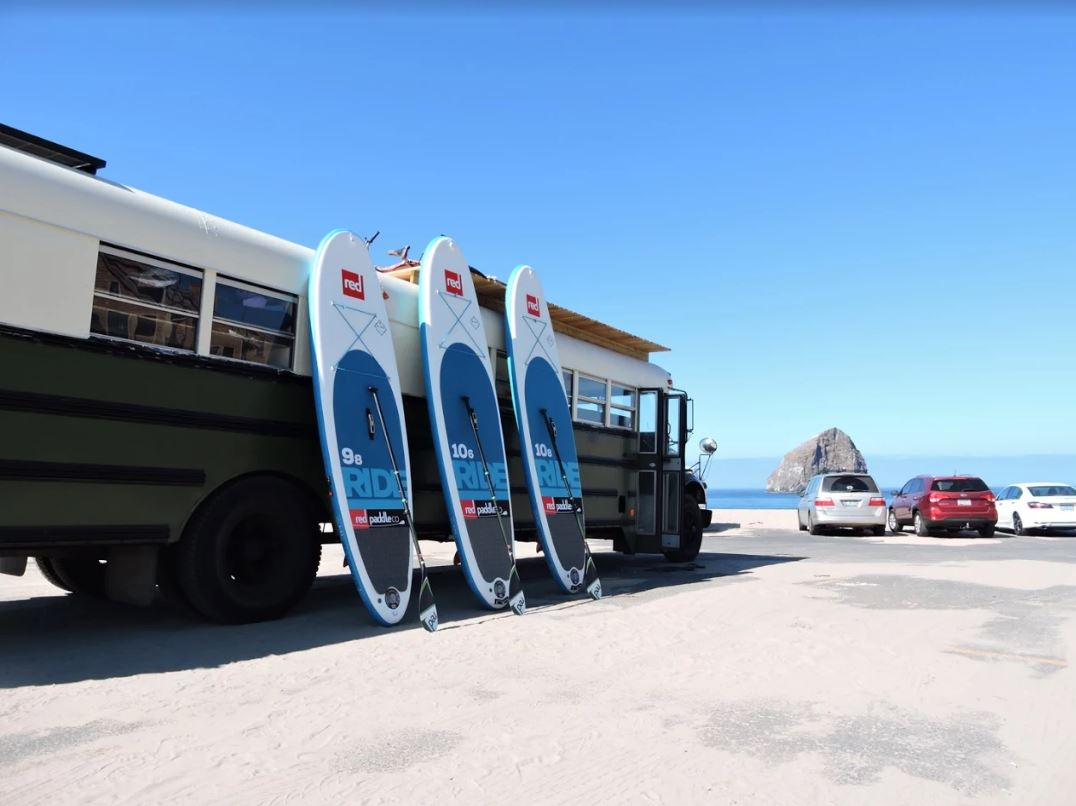Three Ride Paddle Boards and Bus