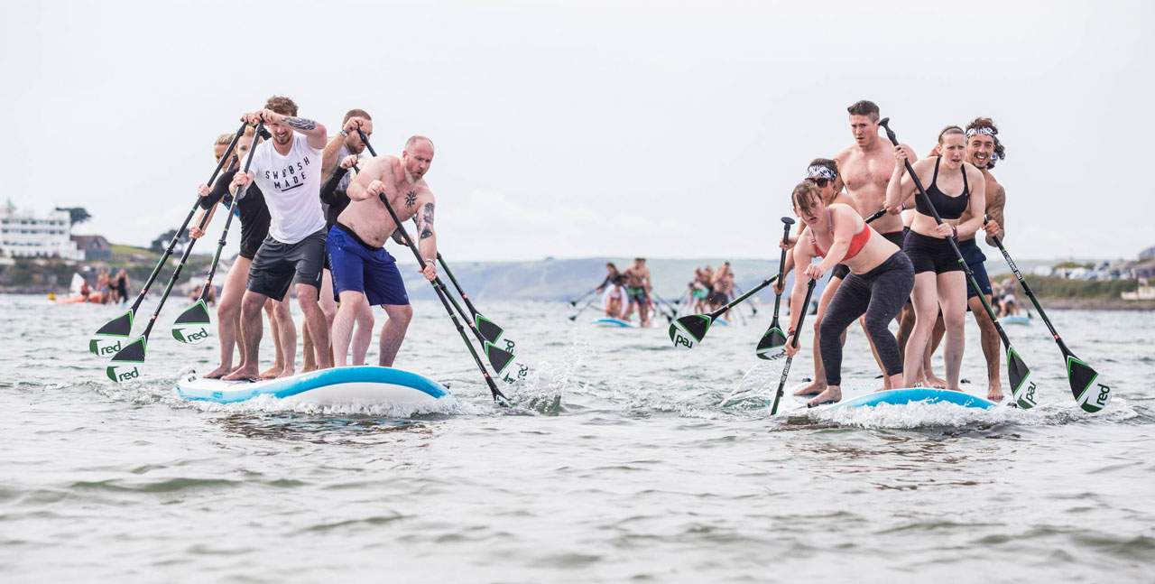 Paddle boarders racing