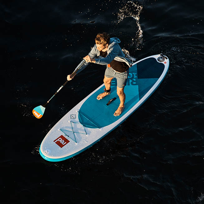 "man paddling 10'6"" Ride aerial shot"