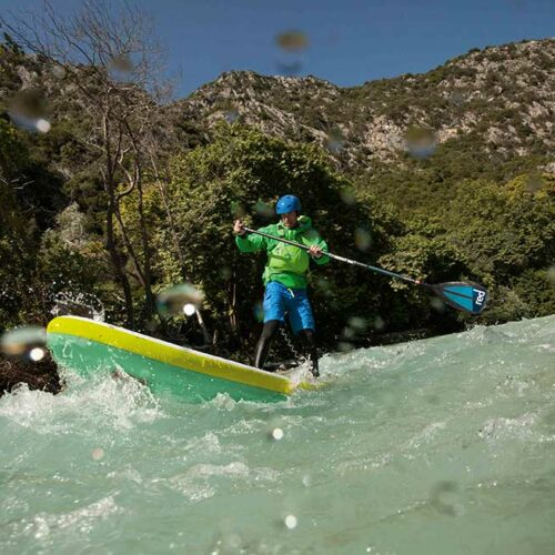 White water action using a carbon nylon paddle