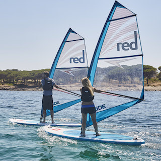 Image of two people windsurfing