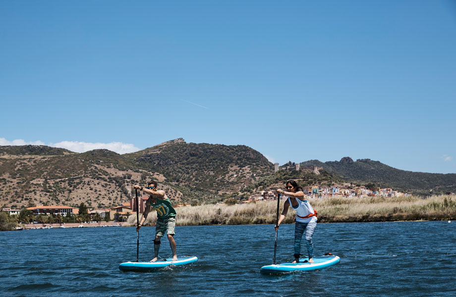 couple paddle boarding in Bosa, Sardinia