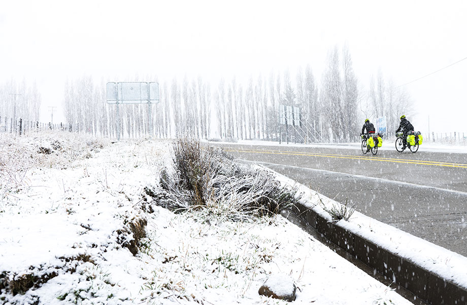 cyclists in snow