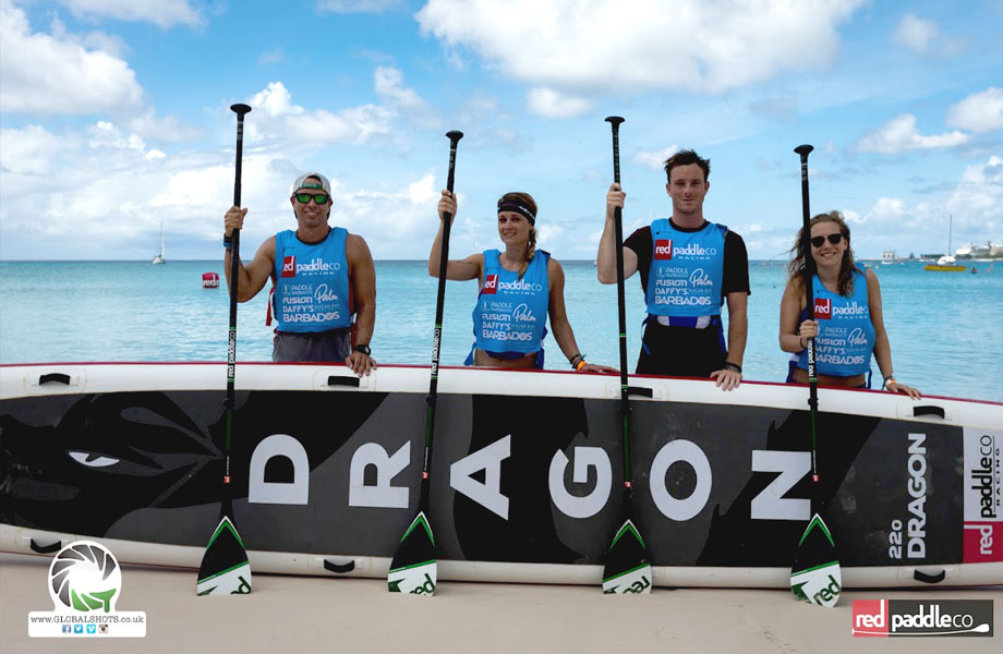 paddle board team pose with 22ft dragon board