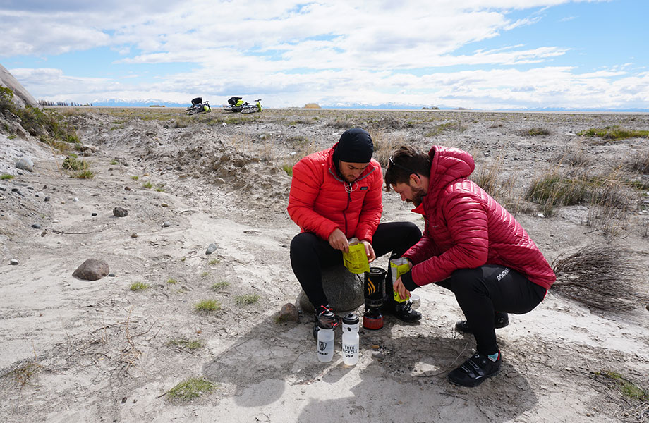 explorers stops for refreshment on the roadside in Patagonia