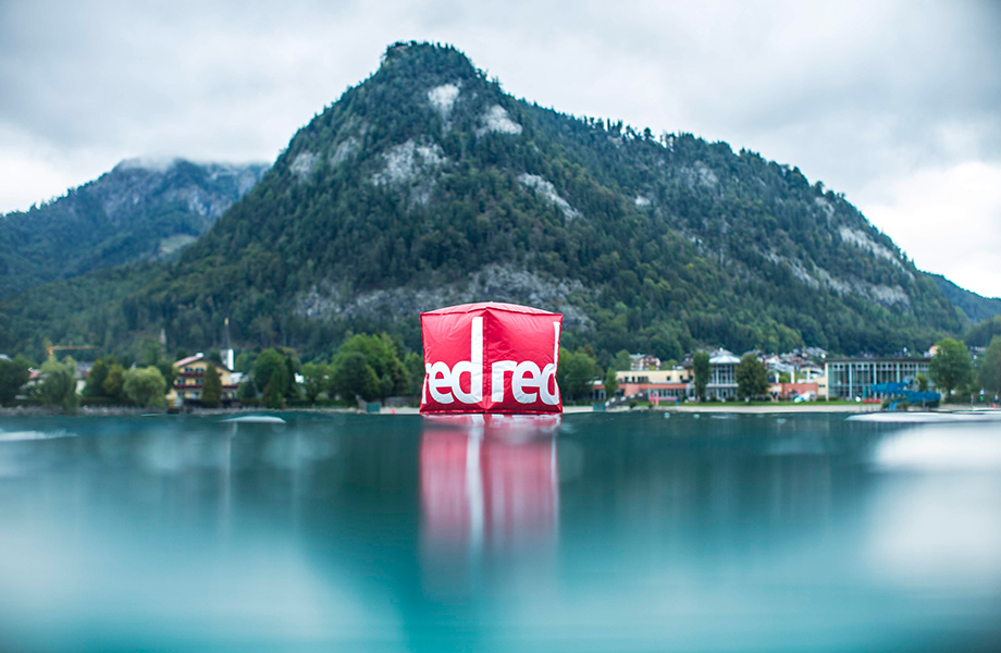 Giant red buoy in the water infant of the mountain.