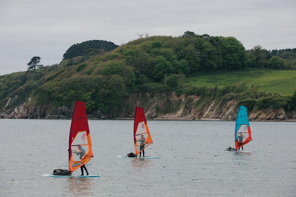 3 Males Windsurfing