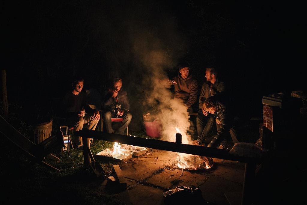 Men Sitting around a campfire