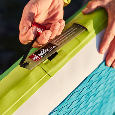 paddler pulls out RSS baton from inflatable SUP