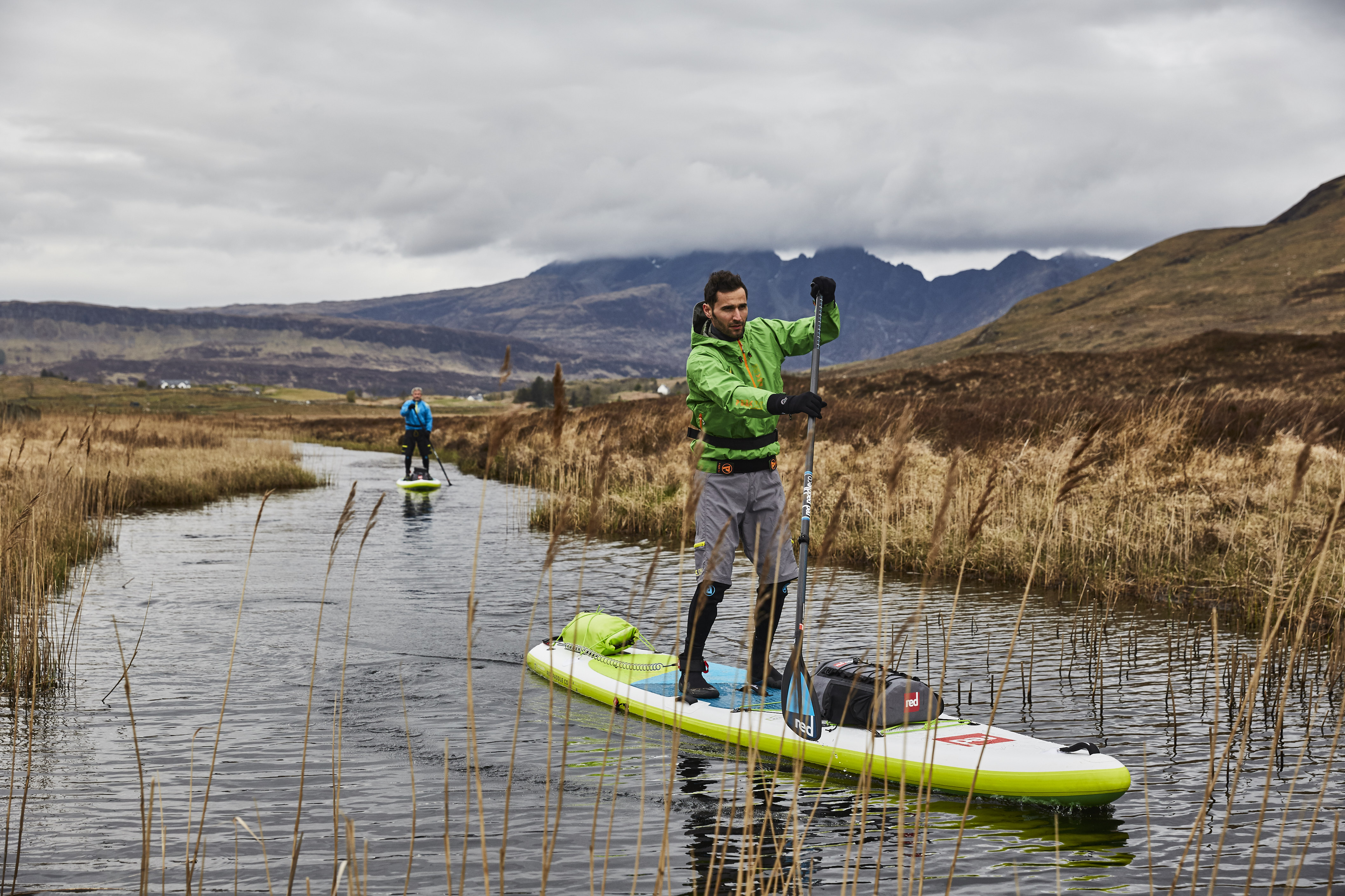 two men paddle boarding in winter at Isle of Skye, Scotland