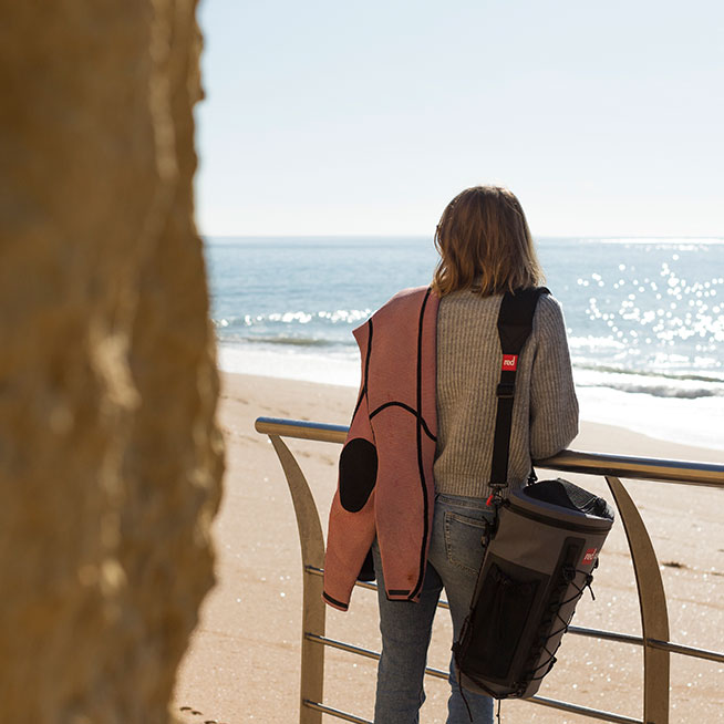 Female looking at ocean with Deckbag on carry strap