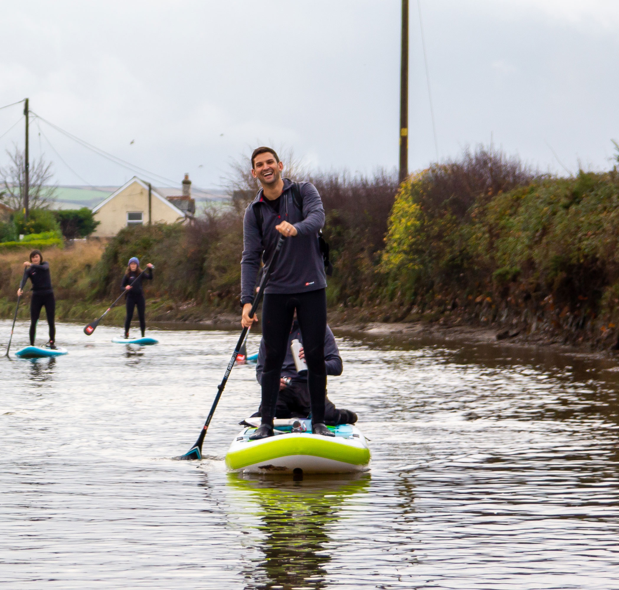 Man paddles on Tandem inflatable SUP