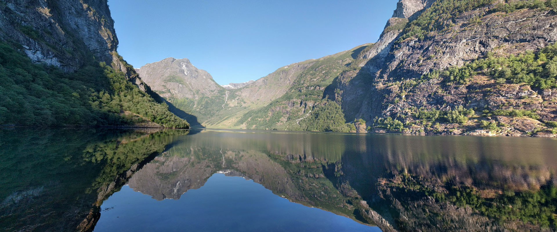 Norwegian mountains reflected in the water of the fjords