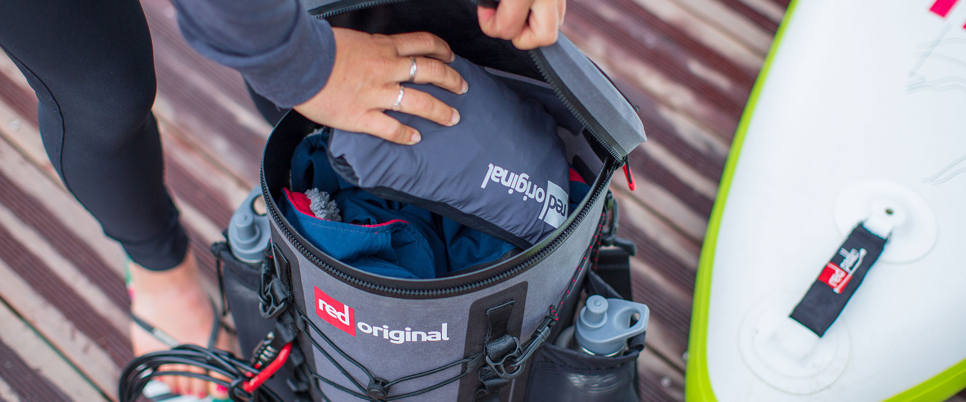 Red OriginalActive Jacket compact and placed in SUP Deck Bag