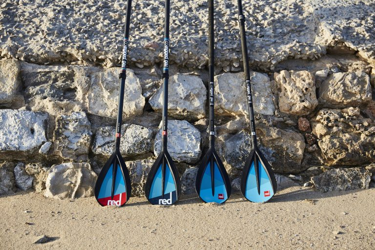 4 Red Paddle Co Sup Paddles Against A Wall In Portugal