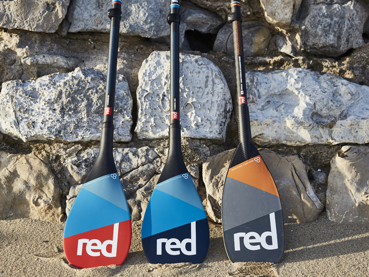 3 Red Paddle Co Sup Paddles Against A Wall In Portugal