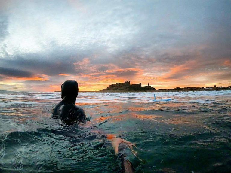 wild swimming at sunset